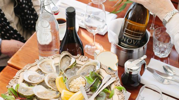 Table with oysters and wine